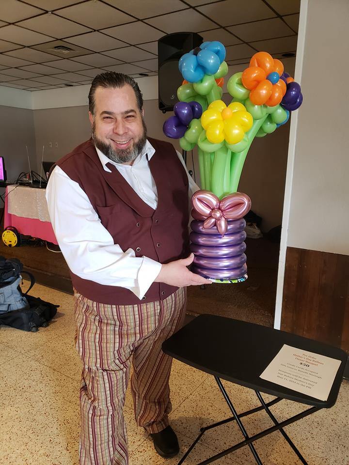 Mother's Day Delivery of Balloon Flower Bouquet is being held by Appleton Magician and Balloon artist, The Amazing Zoomalata